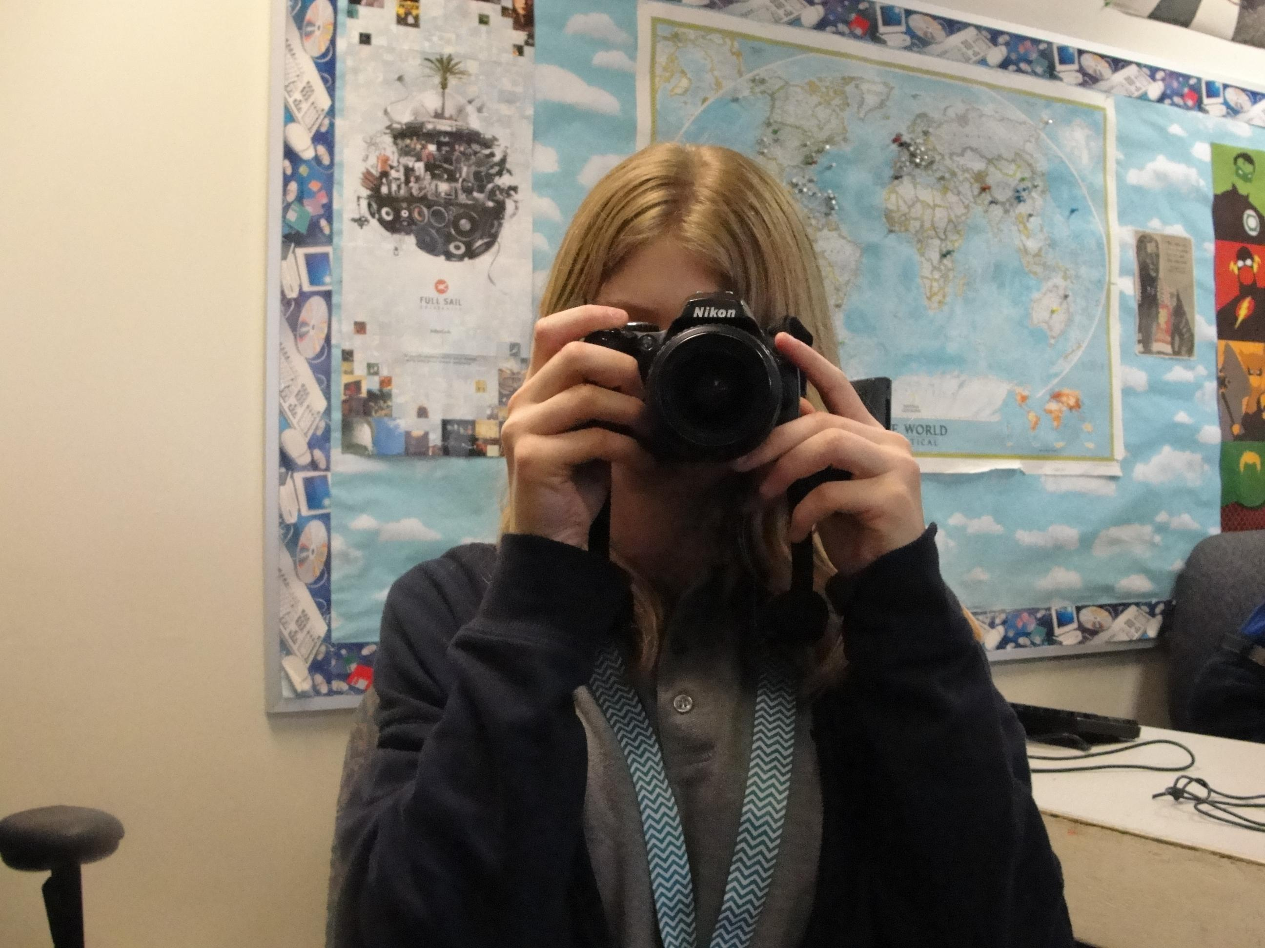 Female Student with Camera